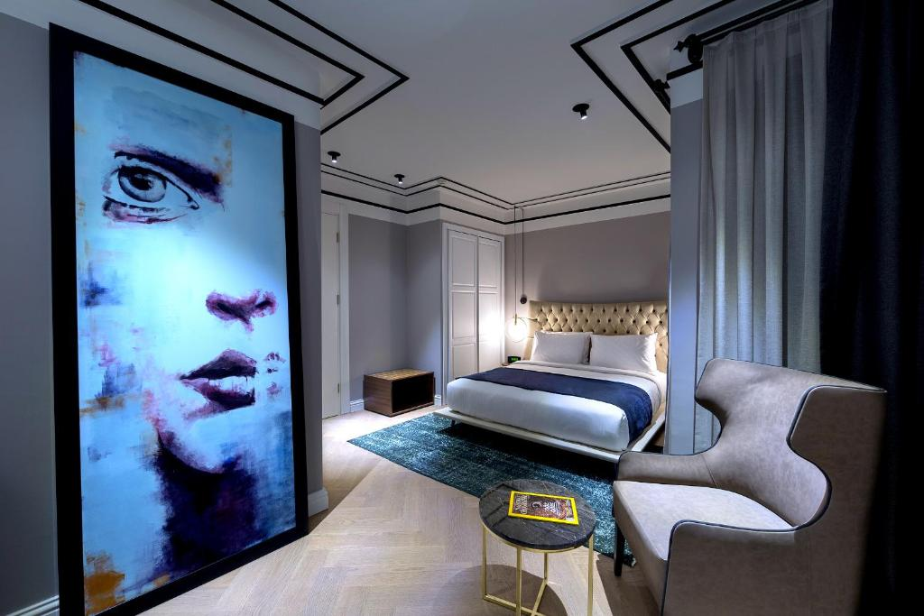 A bed or beds in a room at Walton Hotels Galata