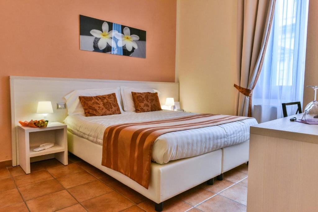 Letto o letti in una camera di Hotel Bella Firenze