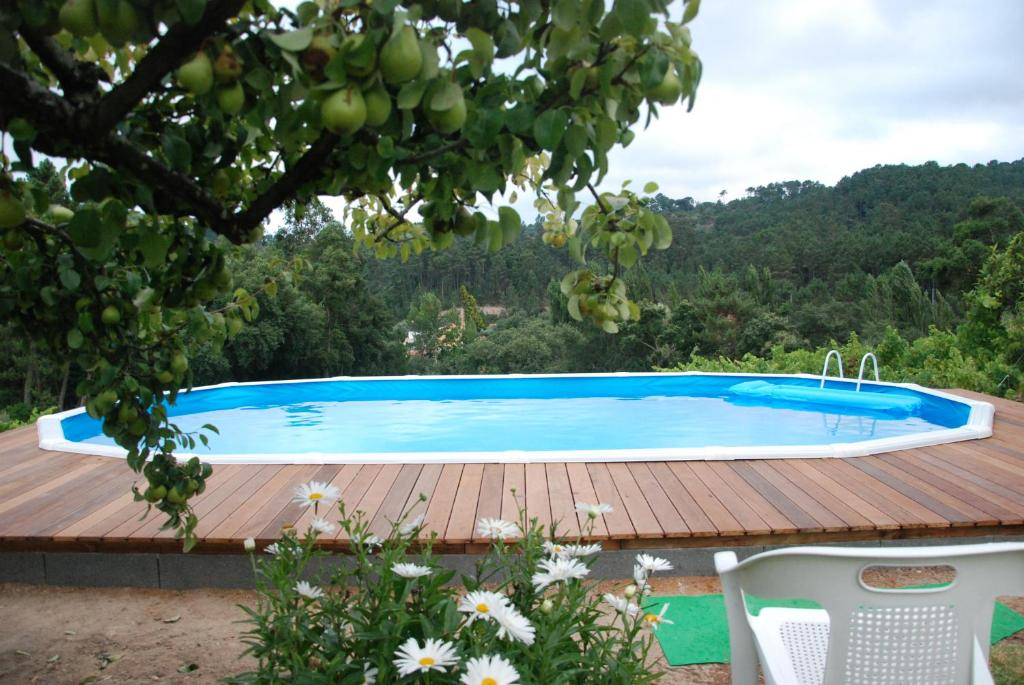 The swimming pool at or near Casa da Costureira