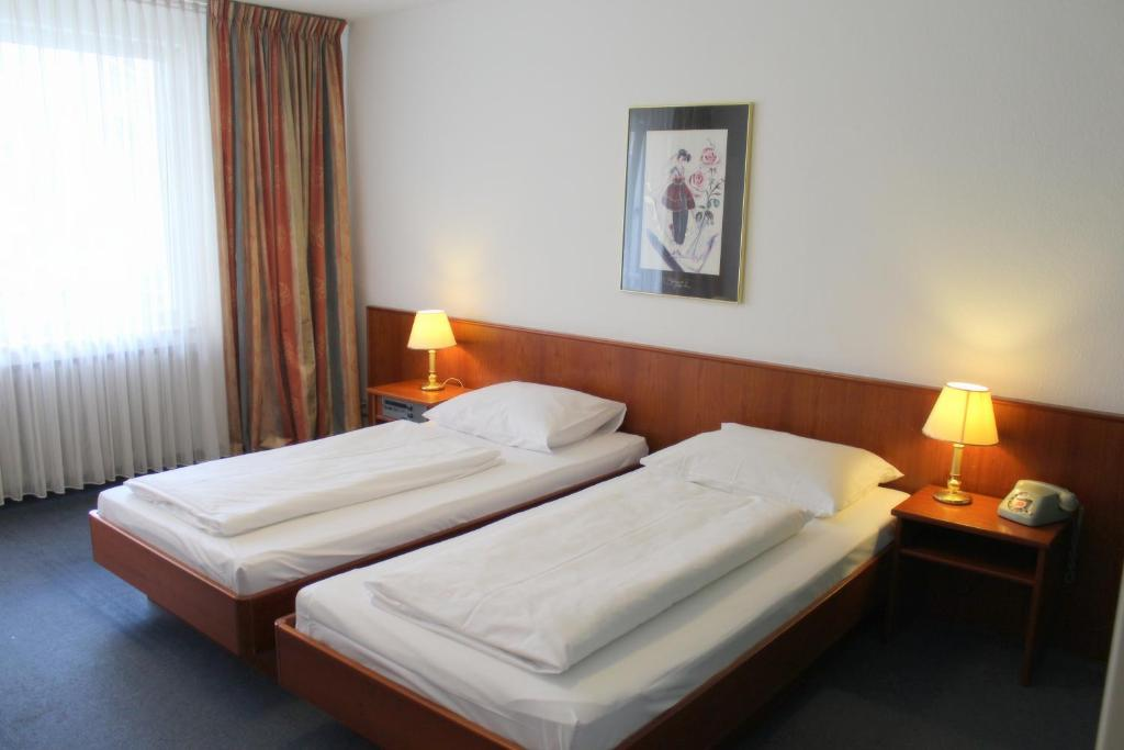 A bed or beds in a room at Hotel Acon