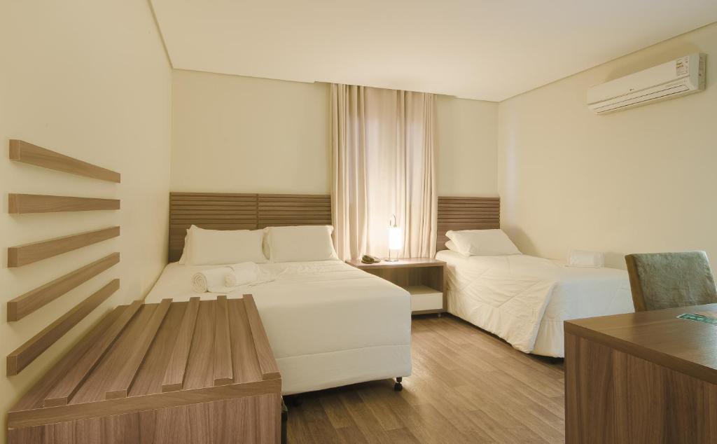 A bed or beds in a room at Umbu Hotel Porto Alegre - Próx a Santa Casa - Possui estacionamento com custo adicional