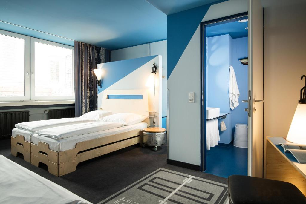 A bed or beds in a room at Superbude Hotel Hostel St. Georg