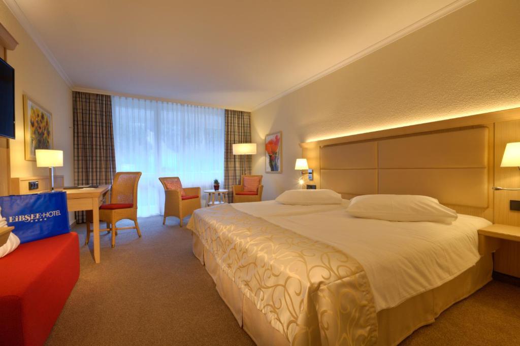Un ou plusieurs lits dans un hébergement de l'établissement Eibsee Hotel