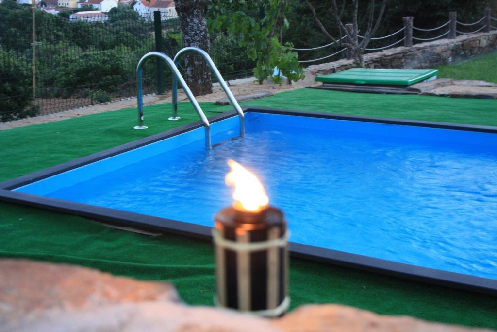 The swimming pool at or near Casas do Bairrinho
