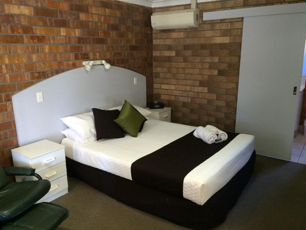 A bed or beds in a room at Miles Outback Motel