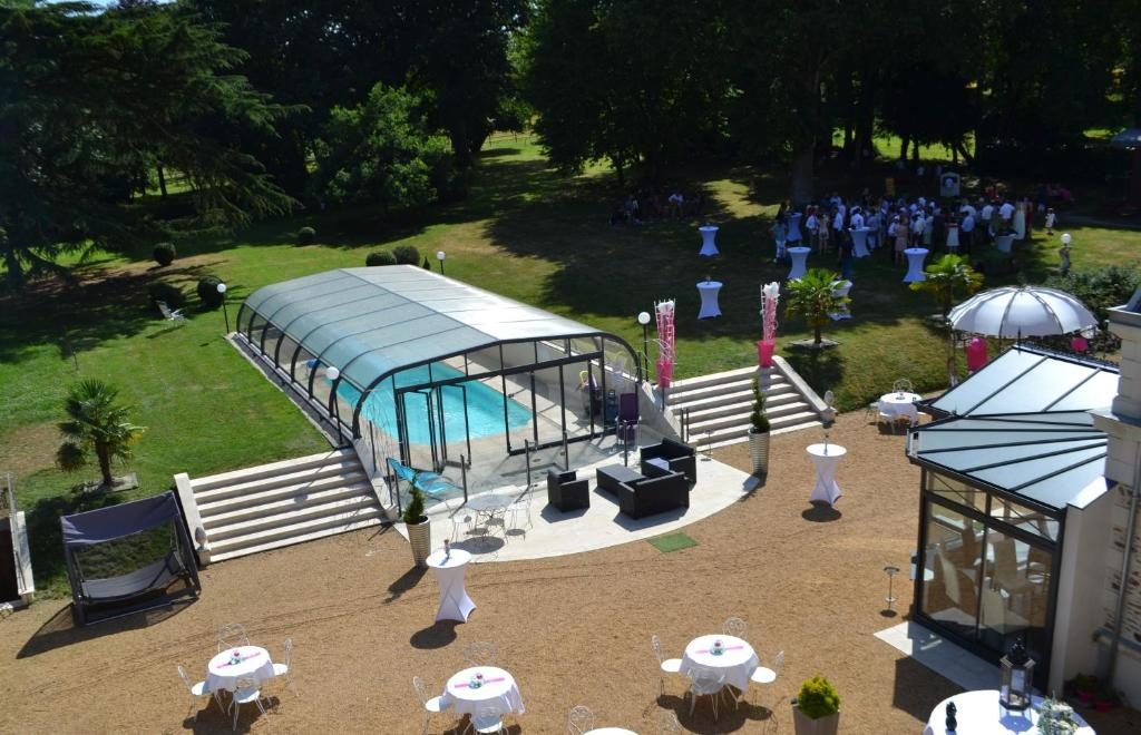 A view of the pool at Le Domaine du Chêne Vert or nearby