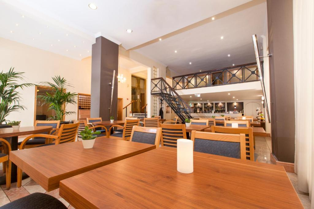 A restaurant or other place to eat at Telioni Hotel