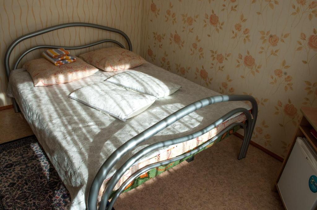 Кровать или кровати в номере Аригус