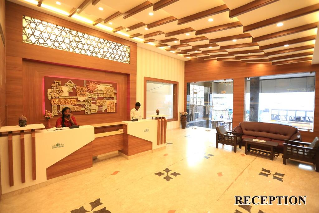 The lobby or reception area at Hotel Deepam