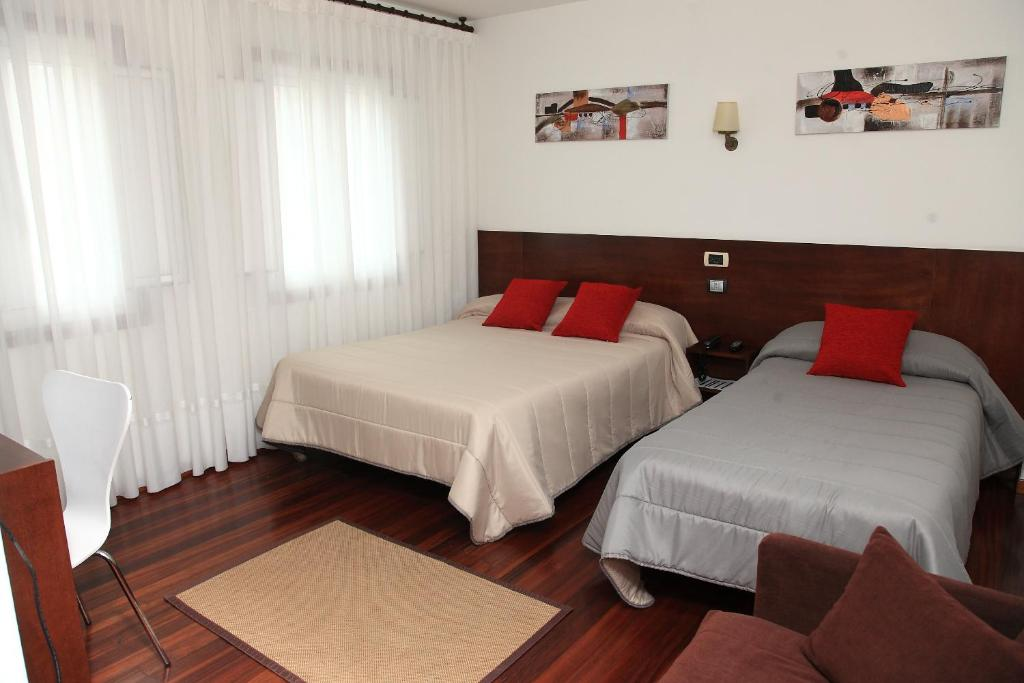 Cama o camas de una habitación en Hotel Restaurante Rúas