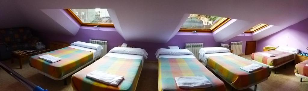 A bed or beds in a room at Hostal Ciudad de Nájera