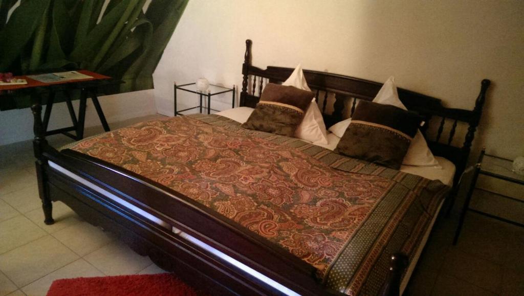 Ein Bett oder Betten in einem Zimmer der Unterkunft Fräulein Sonntag-Gästehaus
