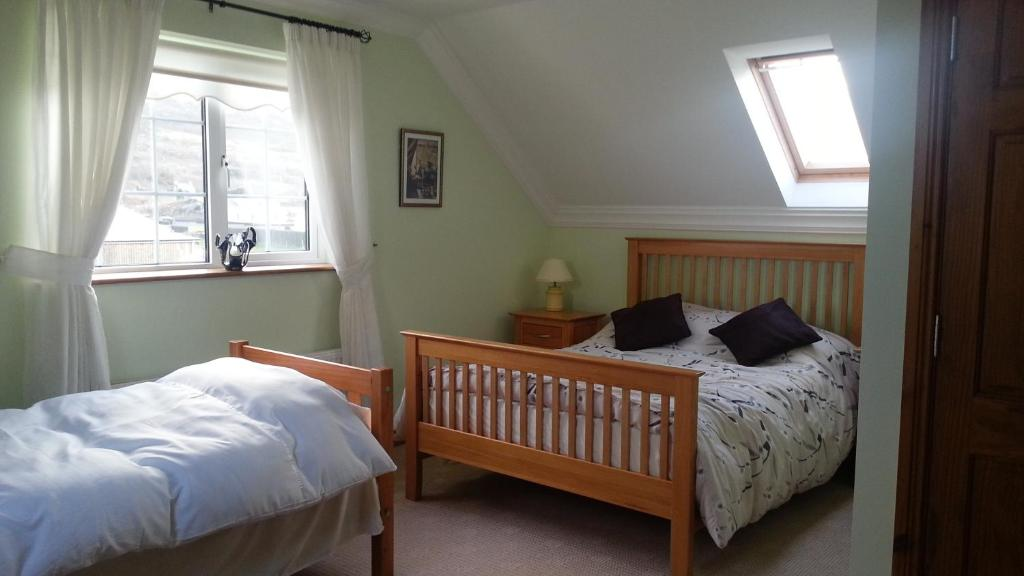A bed or beds in a room at Bindaree Bed & Breakfast