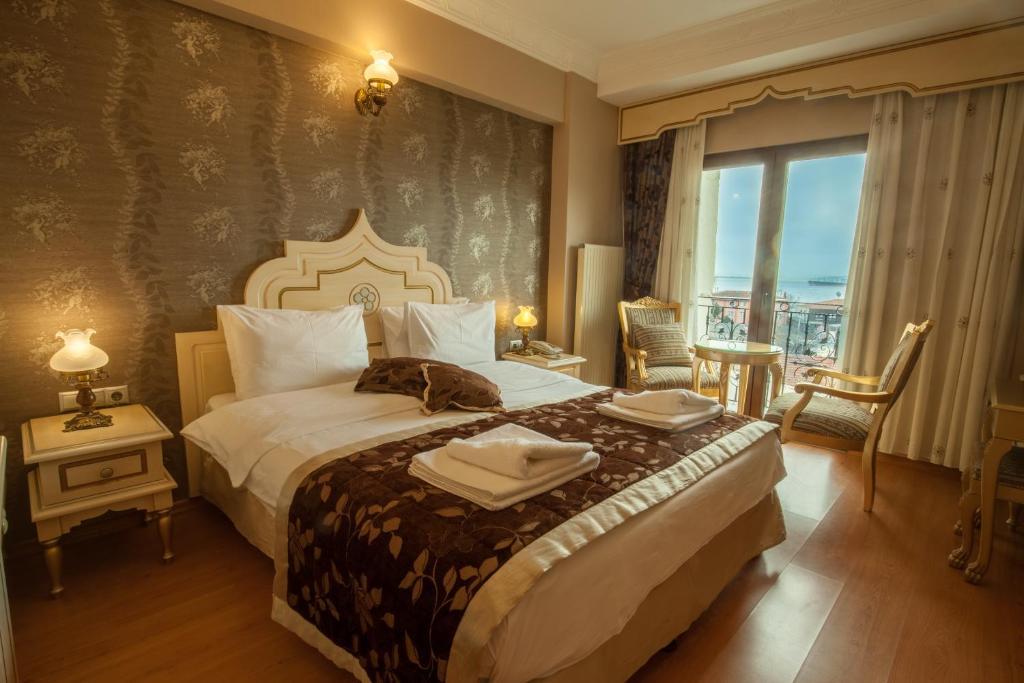 Кровать или кровати в номере Saba Sultan Hotel