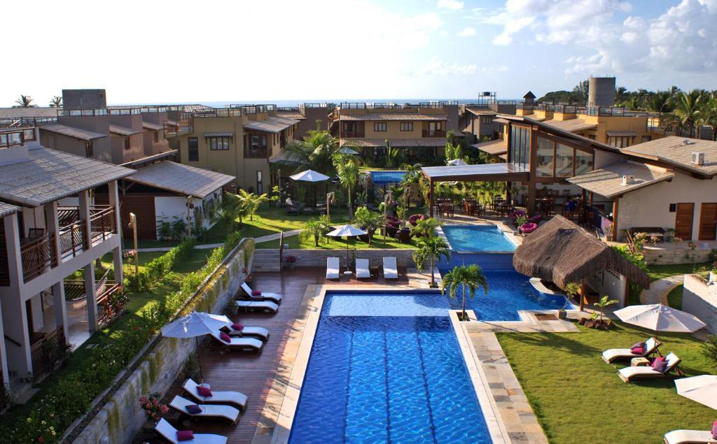 Uma vista da piscina em Apartamentos no Condomínio Pipa Beleza Resort ou nos arredores
