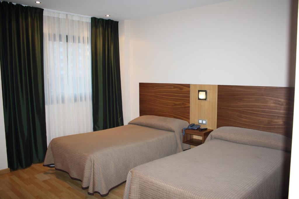 Cama o camas de una habitación en Hotel Mar de Plata