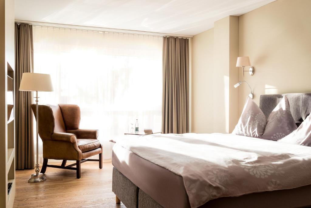 Ein Bett oder Betten in einem Zimmer der Unterkunft Parkhotel Langenthal