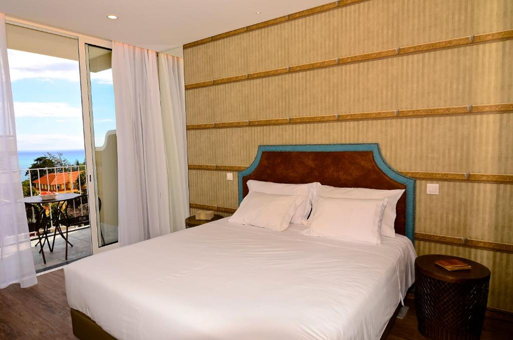 A bed or beds in a room at Vila Toca