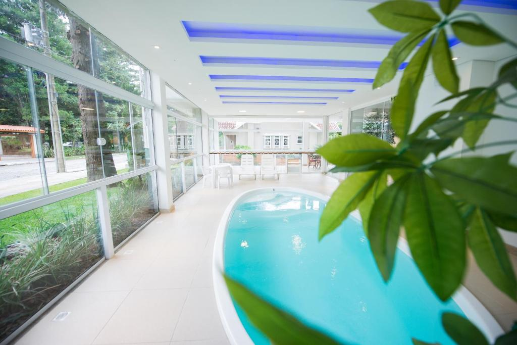 The swimming pool at or close to Sky Premium Hotel Gramado - Ótima Localização