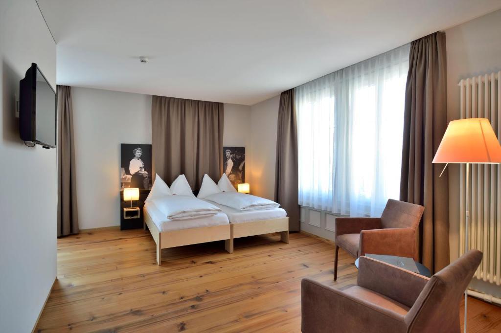 Ein Bett oder Betten in einem Zimmer der Unterkunft Landhaus Burgdorf