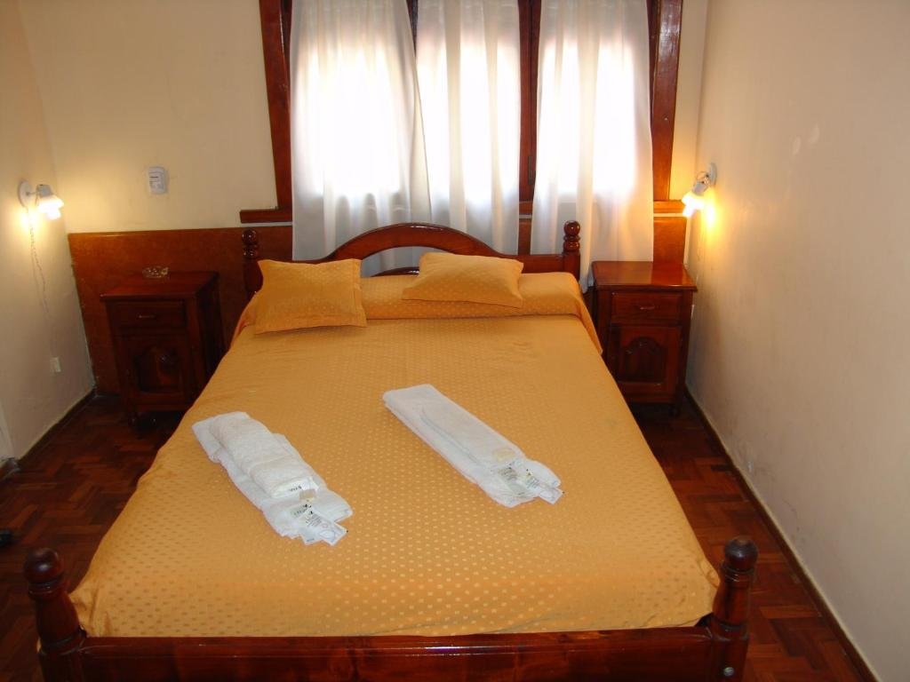 A bed or beds in a room at Hotel Sol y Mar