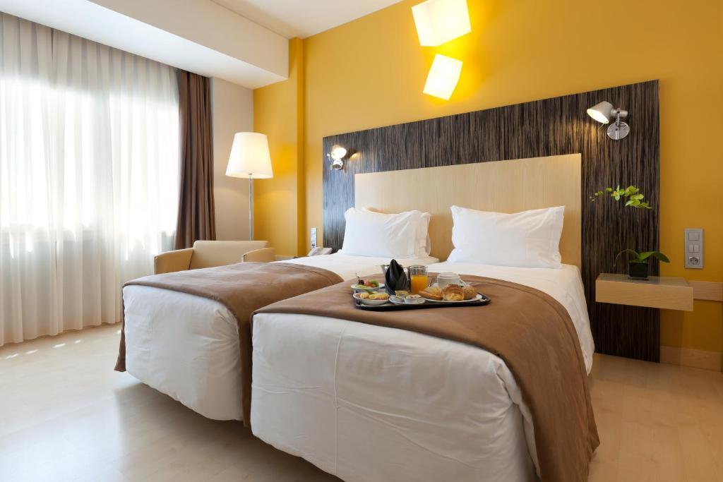 Cama o camas de una habitación en Hotel Alif Avenidas