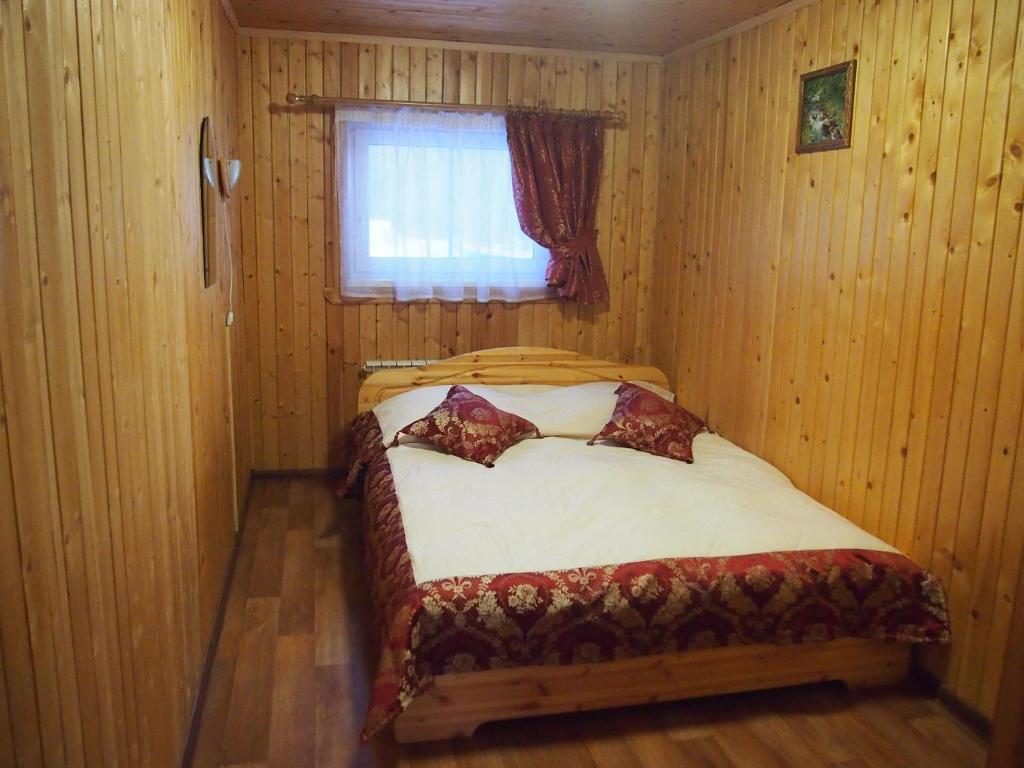Кровать или кровати в номере Гостевой Дом Улейма