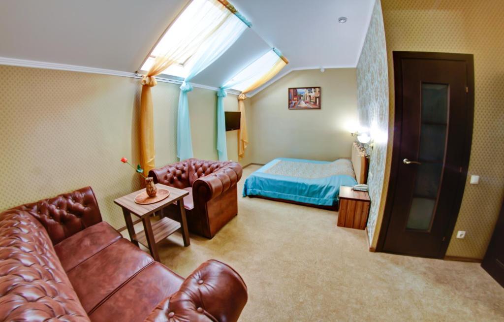 Кровать или кровати в номере Гостевой Дом Звезда