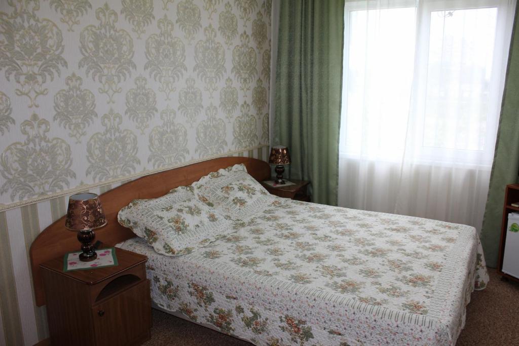 Кровать или кровати в номере Гостевой дом Алла
