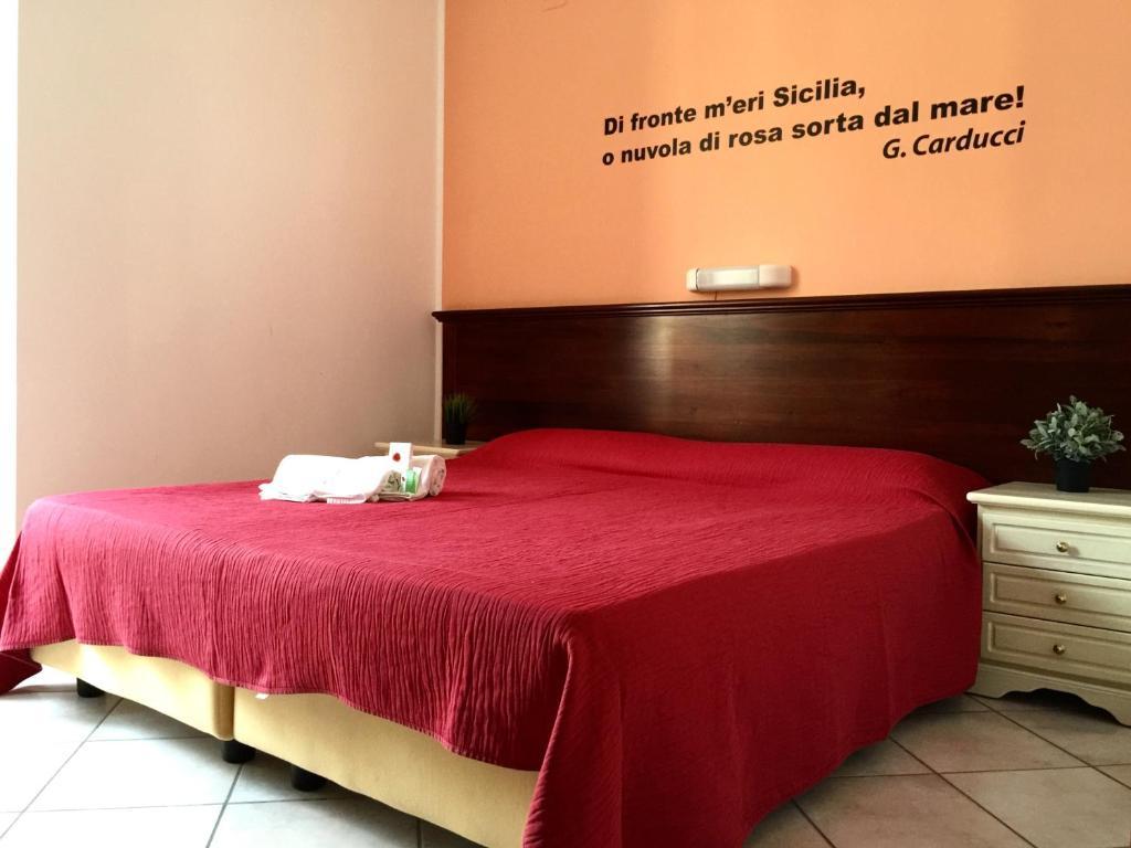 Cama o camas de una habitación en Mamamia Guesthouse