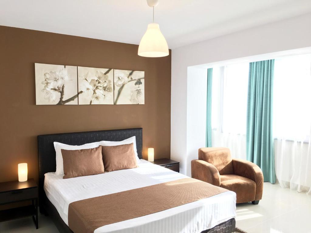 A bed or beds in a room at Elysium