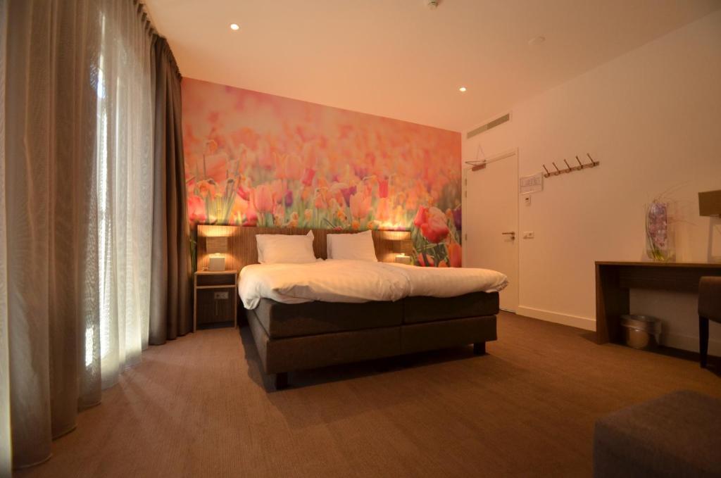 Een bed of bedden in een kamer bij Hotel Restaurant de Engel