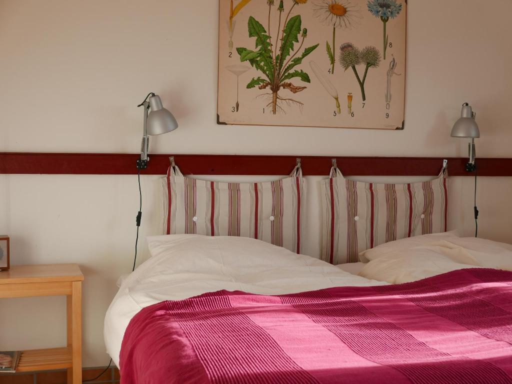 Säng eller sängar i ett rum på Lekanders Bär & Boende