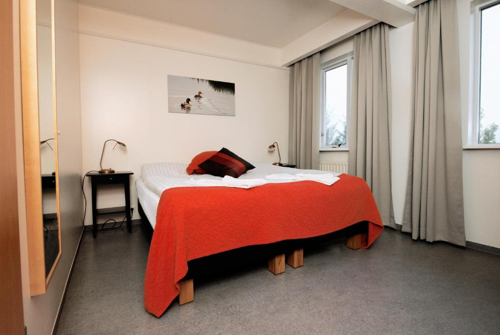 A bed or beds in a room at Hotel Varmahlíd