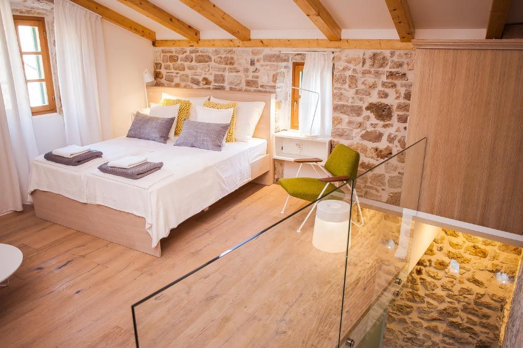 Krevet ili kreveti u jedinici u objektu Castrum Design Apartments