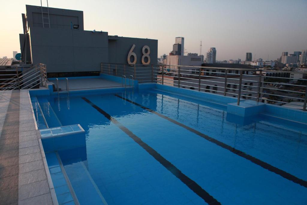 The swimming pool at or close to Bangkok 68