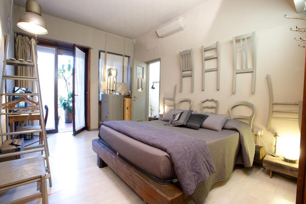 Letto o letti in una camera di Bed+Art Milano Centrale