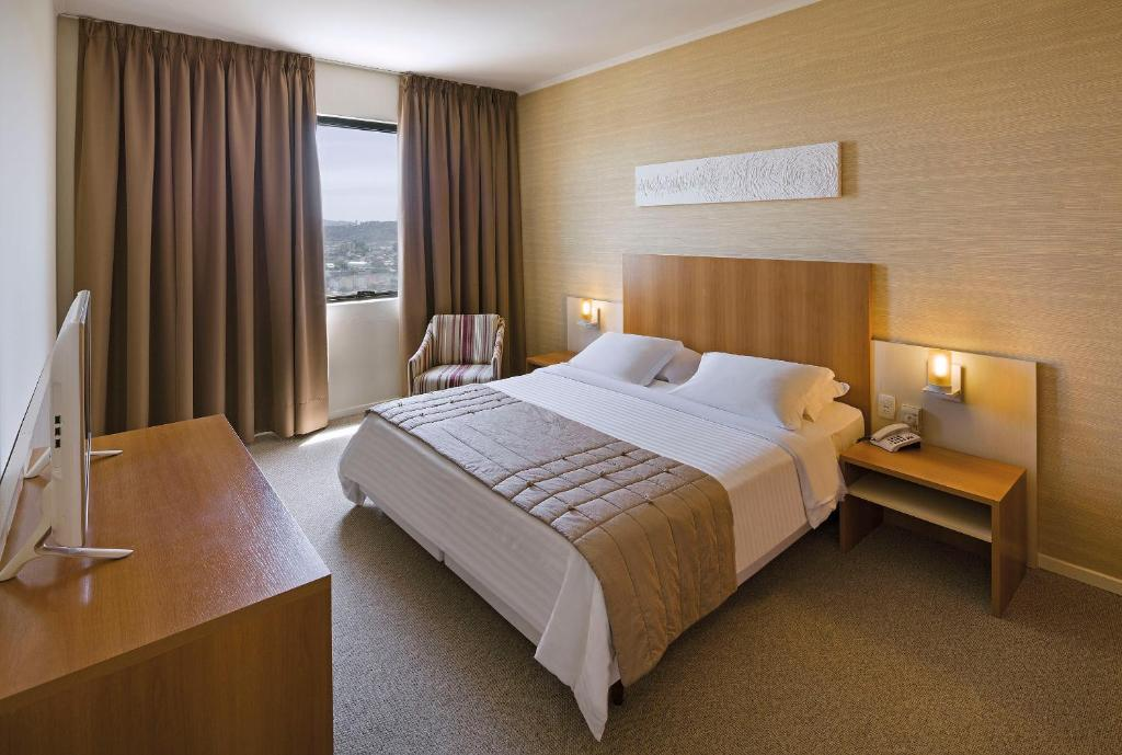 A bed or beds in a room at Swan Novo Hamburgo