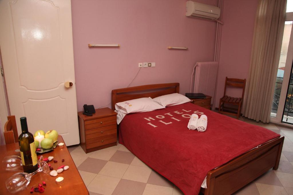 Ένα ή περισσότερα κρεβάτια σε δωμάτιο στο Ilios