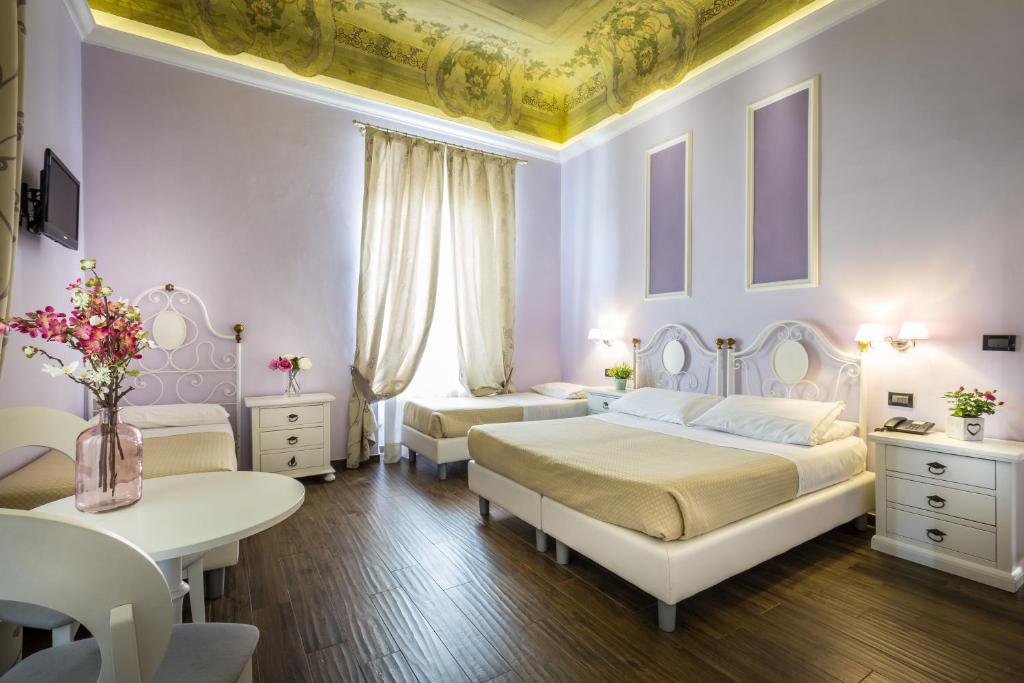 Cama o camas de una habitación en Hotel Ferrucci