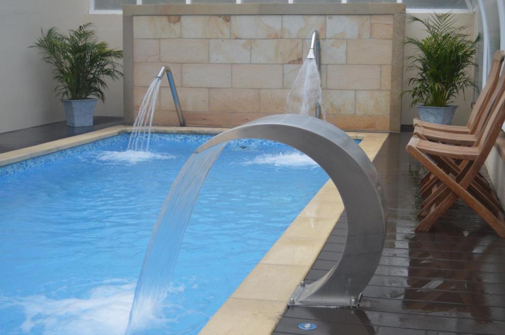 The swimming pool at or near Hotel Balneario De Alceda