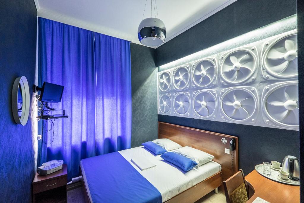Кровать или кровати в номере Погости на Ленинградском проспекте