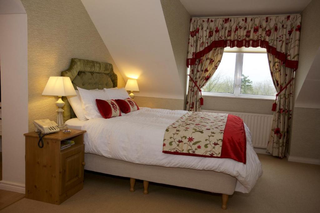 A bed or beds in a room at Abocurragh Farmhouse Bed and Breakfast