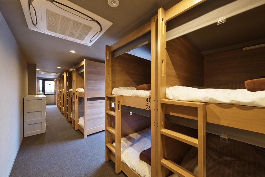A bunk bed or bunk beds in a room at Kaede Guesthouse