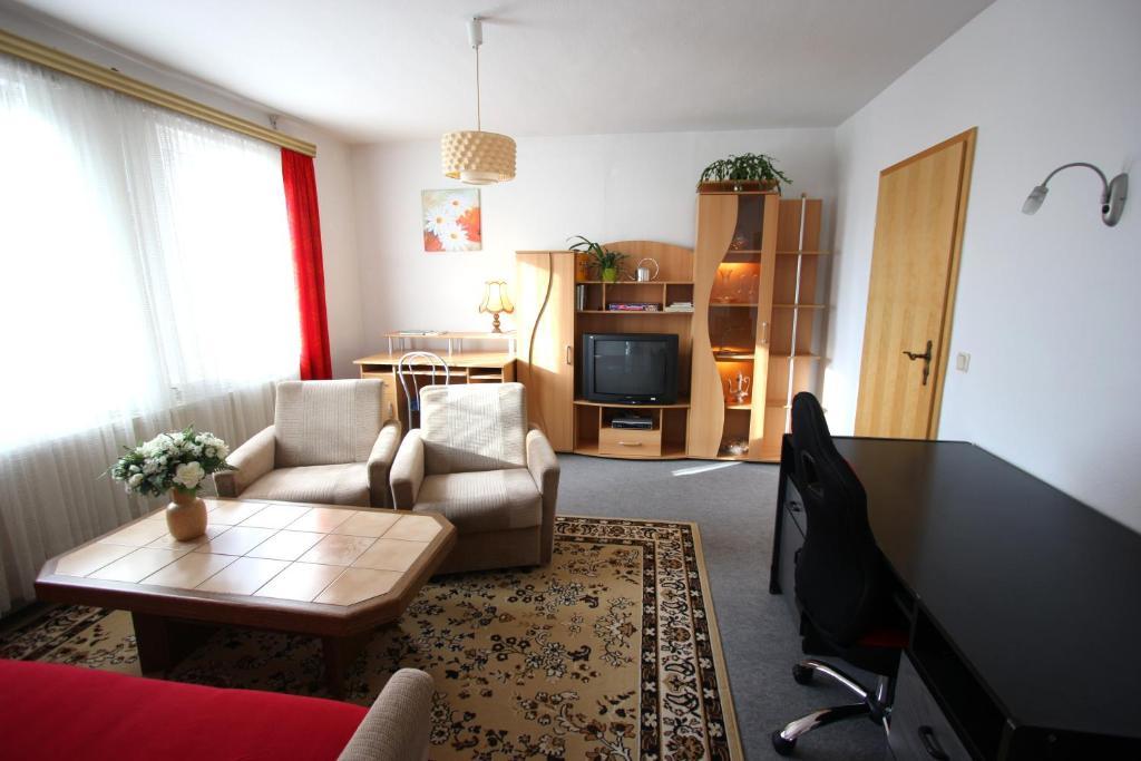 Ein Sitzbereich in der Unterkunft Karin's behagliche Ferienwohnung