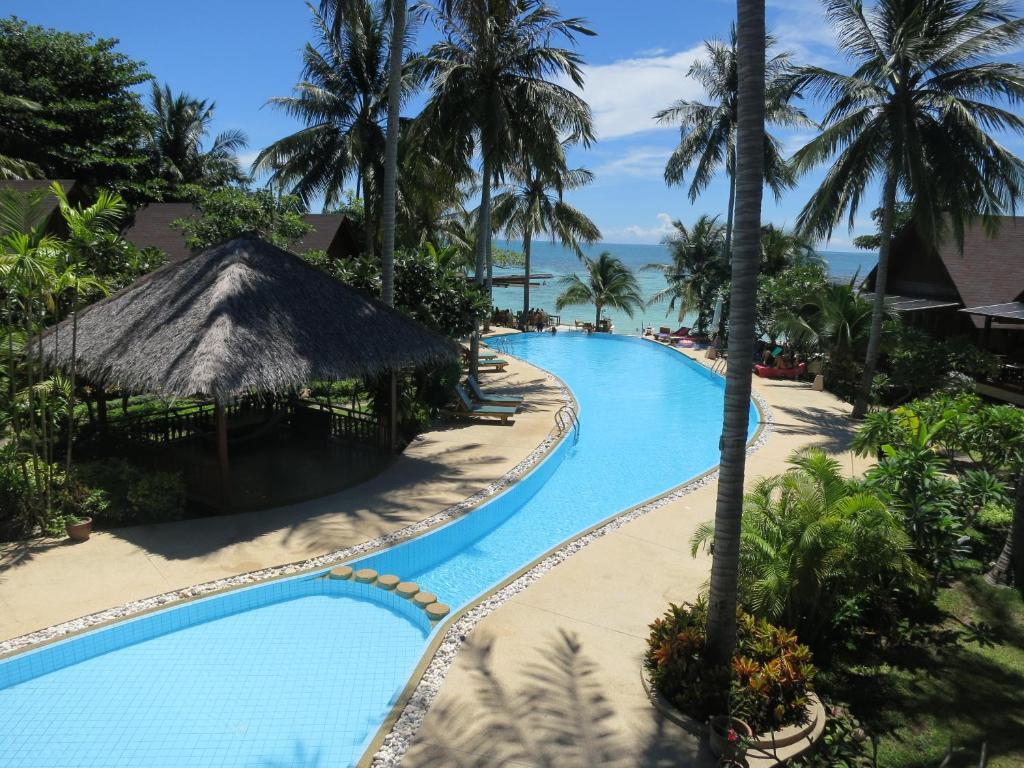 Vue sur la piscine de l'établissement Green Papaya Resort ou sur une piscine à proximité