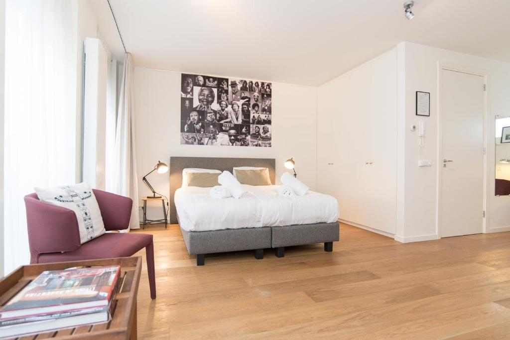 Un ou plusieurs lits dans un hébergement de l'établissement Apartments Grote Bickersstraat