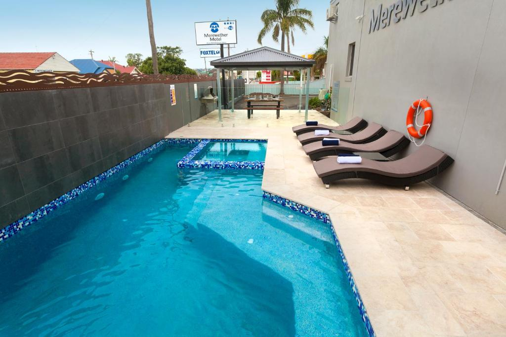 The swimming pool at or near Merewether Motel