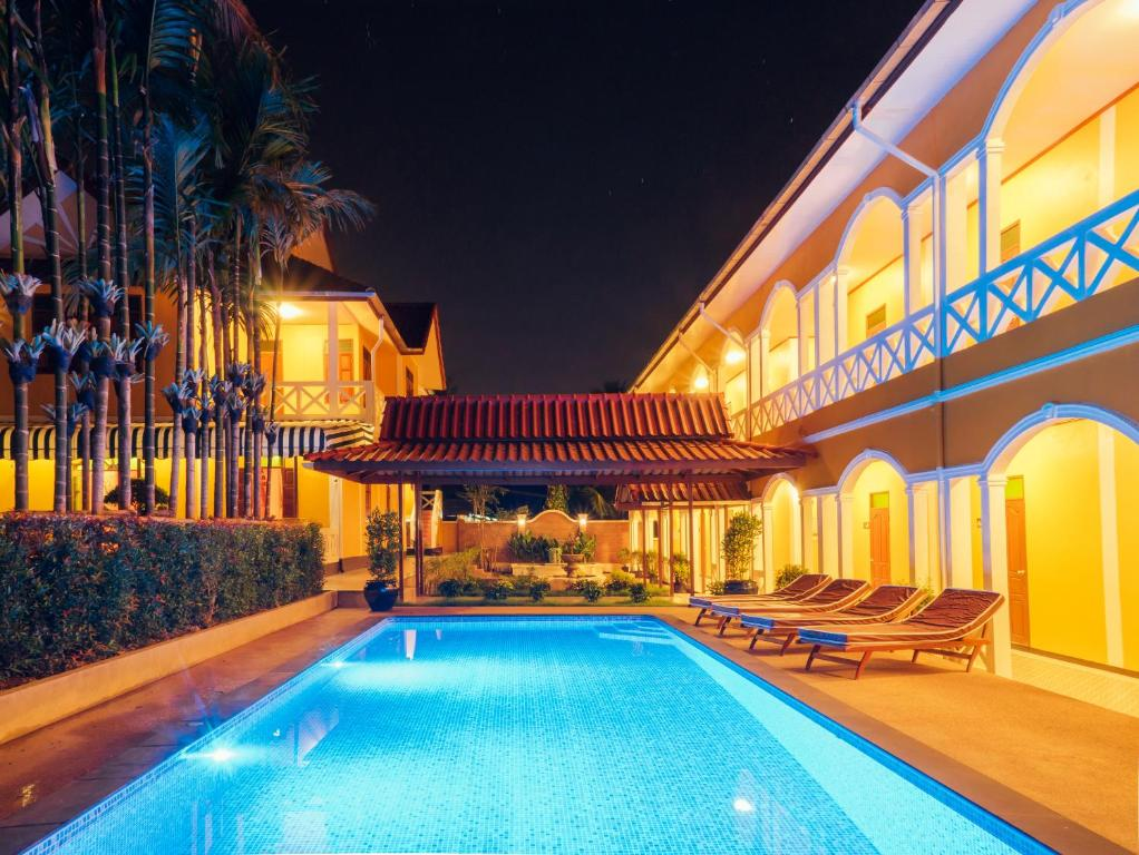 The swimming pool at or near Le Jardin Hotel