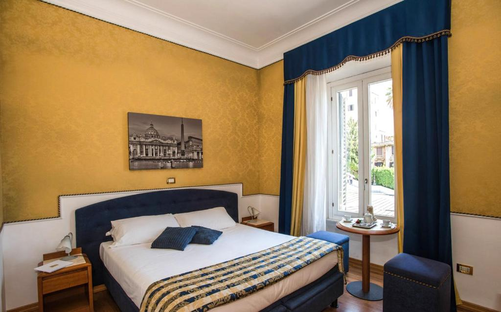 Letto o letti in una camera di iH Hotels Piazza di Spagna View - Luxury Guest House